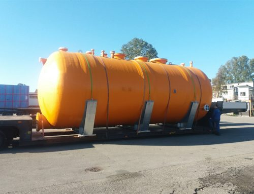 Transporting a large container for storage of alkalis and acids